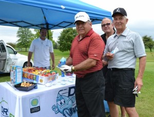 "(Background): Dry FX Sponsor Mark Douma, (front from left): Victor Villarreal, Treasure Chest Board Member John Waiting and Jimmy Finkel. John Waiting said, ""We're here to help the Treasure Chest Foundation."""